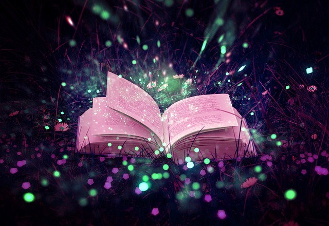 Magical looking open book with pink and green lighting and sparks